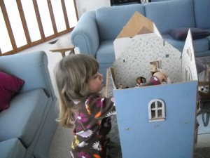Nina discovers Goldie's doll house